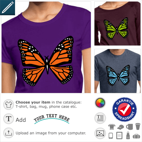 Graphic butterfly with orange motifs on black wings, dotted with small white dots like snow.